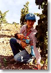 Young vines, Carol Perata and first child.